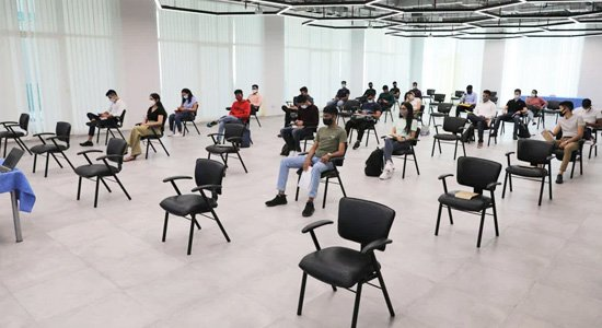 Students are seated socially distanced