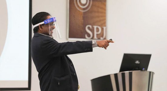 Faculty members use a face shield when conducting a lecture